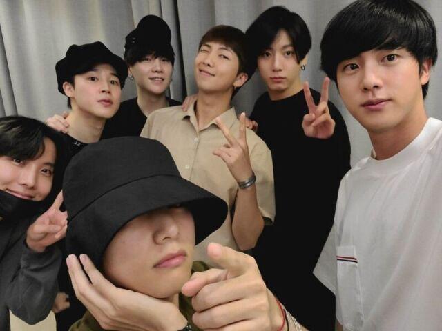 Escolha uma foto e te indicarei uma música do BTS!